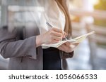 young woman journalists are...   Shutterstock . vector #1056066533