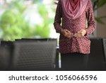 muslim pregnant women   close up | Shutterstock . vector #1056066596