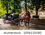 horse carriage in bruges city ... | Shutterstock . vector #1056110180