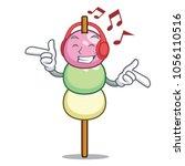 listening music dango mascot... | Shutterstock .eps vector #1056110516