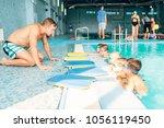 instructor talking to children... | Shutterstock . vector #1056119450