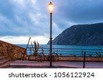 street lamp lantern turned on... | Shutterstock . vector #1056122924
