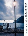 street lamp lantern turned on... | Shutterstock . vector #1056122930