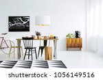patterned carpet  wooden table... | Shutterstock . vector #1056149516