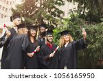 a group of multietnic students... | Shutterstock . vector #1056165950
