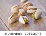 pistachio nut on wood table