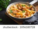 penne pasta in tomato sauce... | Shutterstock . vector #1056183728