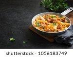penne pasta in tomato sauce... | Shutterstock . vector #1056183749