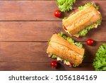 ciabatta sandwich with lettuce  ... | Shutterstock . vector #1056184169