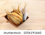 dried salt fish on the wood | Shutterstock . vector #1056191660
