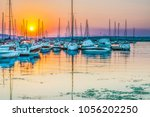 boats and yachts on the quay in ... | Shutterstock . vector #1056202250