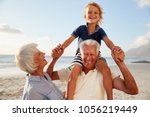 grandparents carrying grandson... | Shutterstock . vector #1056219449