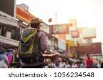 young asian traveling man... | Shutterstock . vector #1056234548