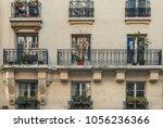 aged vintage building facade... | Shutterstock . vector #1056236366