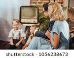 happy 1950s style parents... | Shutterstock . vector #1056238673