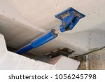 Small photo of under bridge massive Hydraulic damper used to dissipate the large amounts of energy that result from sudden dynamic loading like earthquakes.