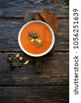 tomato soup with cheese  olives ... | Shutterstock . vector #1056251639