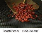goji berries useful fruit...   Shutterstock . vector #1056258509
