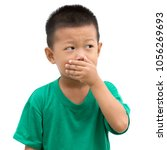 asian child covering his mouth... | Shutterstock . vector #1056269693