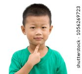 happy asian child pointing his... | Shutterstock . vector #1056269723