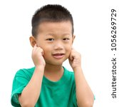 happy asian child pointing his... | Shutterstock . vector #1056269729