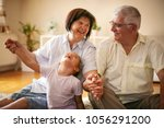 happy family. grandparents with ... | Shutterstock . vector #1056291200