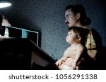 family time spending at evening.... | Shutterstock . vector #1056291338