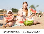 young mother with children... | Shutterstock . vector #1056299654
