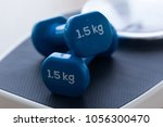 close up of blue dumbbells on... | Shutterstock . vector #1056300470