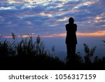 Stock photo the girl who looking the sunset might be waiting for someone 1056317159