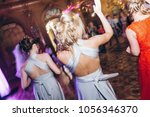 happy stylish people dancing... | Shutterstock . vector #1056346370