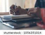 man  freelancer writing on... | Shutterstock . vector #1056351014