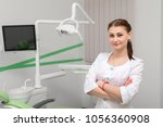 dentist in the office  | Shutterstock . vector #1056360908