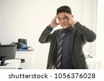 businessman stressed and... | Shutterstock . vector #1056376028