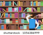 young man chooses a book in the ... | Shutterstock .eps vector #1056386999