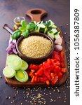 bowl of bulgur with fresh... | Shutterstock . vector #1056387809