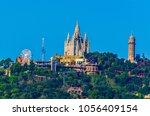 tibidabo amusement park... | Shutterstock . vector #1056409154
