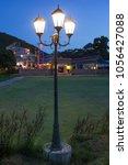 lamp post at night | Shutterstock . vector #1056427088