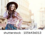 outdoor portrait of a young... | Shutterstock . vector #1056436013