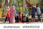 Small photo of Aqaba, Jordan, March 7, 2018: Muslim families take a rest at the back of the beach of Aqaba, middle east