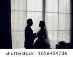 the kiss of the bride and groom ... | Shutterstock . vector #1056454736