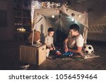 father and son are playing with ... | Shutterstock . vector #1056459464