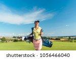 full length rear view of an... | Shutterstock . vector #1056466040