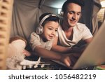 father and son are talking on... | Shutterstock . vector #1056482219