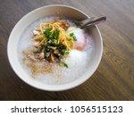 rice porridge  rice gruel or... | Shutterstock . vector #1056515123