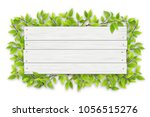 empty white wooden sign with... | Shutterstock .eps vector #1056515276