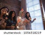 happy group of friends lighting ... | Shutterstock . vector #1056518219