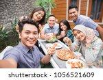 group of friends enjoying meal...   Shutterstock . vector #1056521609