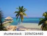 palm trees and dock at a resort ... | Shutterstock . vector #1056526460