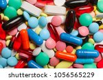 many colorful pills as... | Shutterstock . vector #1056565229